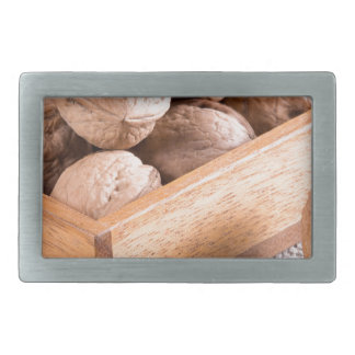 Macro view of walnuts close up in a wooden box belt buckles