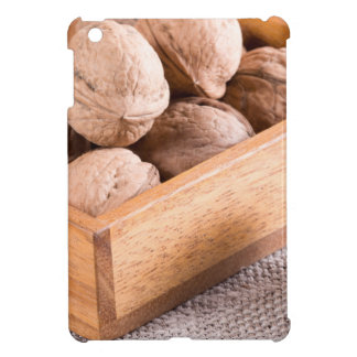 Macro view of walnuts close up in a wooden box iPad mini cases