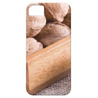 Macro view of walnuts close up in a wooden box iPhone 5 cases