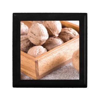 Macro view of walnuts close up in a wooden box keepsake box