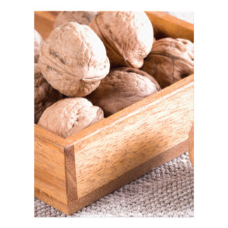 Macro view of walnuts close up in a wooden box letterhead template