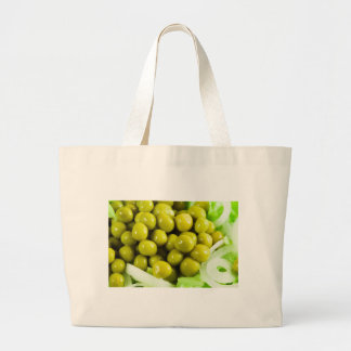 Macro view on a salad of green vegetables large tote bag