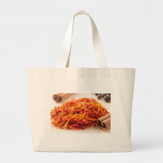 Macro view on fragrant saffron closeup large tote bag