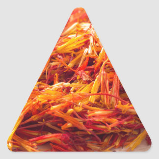 Macro view on fragrant saffron closeup triangle sticker