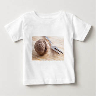 Macro view on walnuts and fork close-up baby T-Shirt