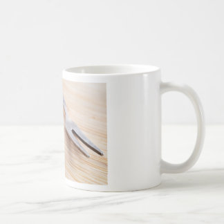 Macro view on walnuts and fork close-up coffee mug