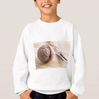 Macro view on walnuts and fork close-up sweatshirt