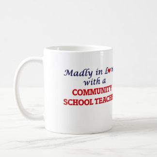 Madly in love with a Community School Teacher Coffee Mug