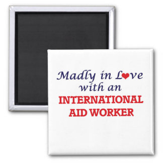 Madly in love with an International Aid Worker Square Magnet