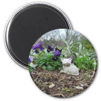 Magnet with cat sculpture in herb garden