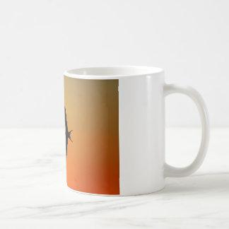 Magnificent frigate bird flying orange sunset coffee mug