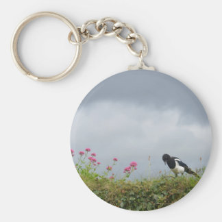 Magpie and wild flowers. keychain