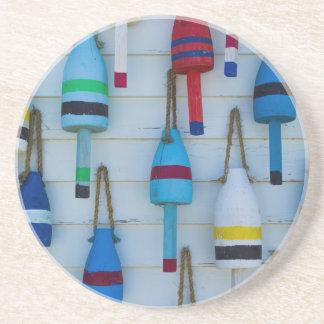 Maine, Stonington, decorative lobster buoys Coasters