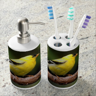Male American Goldfinch on the Arbutus Soap Dispenser And Toothbrush Holder