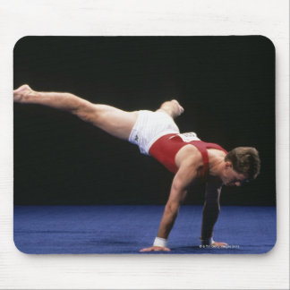 Male gymnast peforming a routine in the floor mouse pad