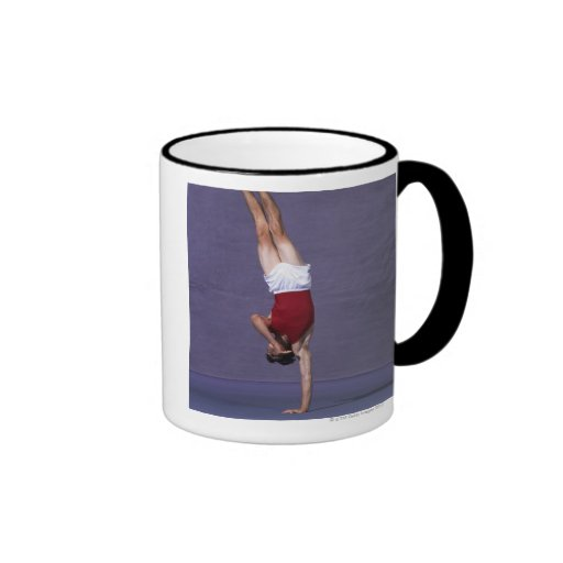 Male gymnast performing on the floor exercise 2 mugs