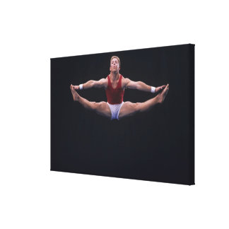 Male gymnast performing on the floor exercise canvas prints