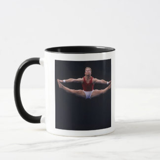 Male gymnast performing on the floor exercise mug