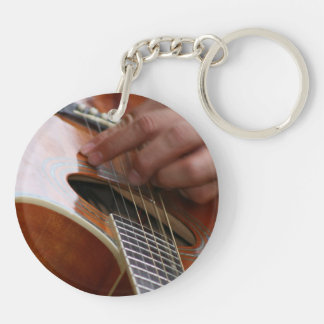 male hand holding pick on acoustic guitar Double-Sided round acrylic keychain