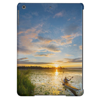 Male kayaker paddling sea kayak on still water cover for iPad air