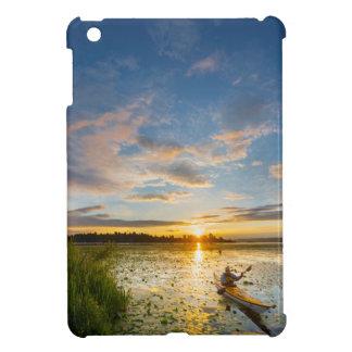 Male kayaker paddling sea kayak on still water iPad mini cases
