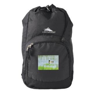 Male mallard duck floating on the water backpack