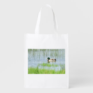 Male mallard duck floating on the water reusable grocery bag