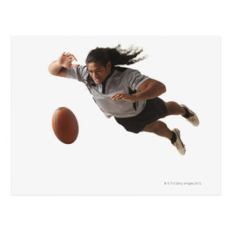 Male rugby player diving for ball postcard