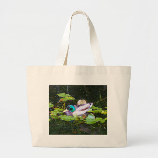 Mallard duck in a pond large tote bag
