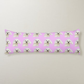 Maltese puppy on pink body pillow