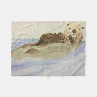 Mama and baby otters fleece blanket
