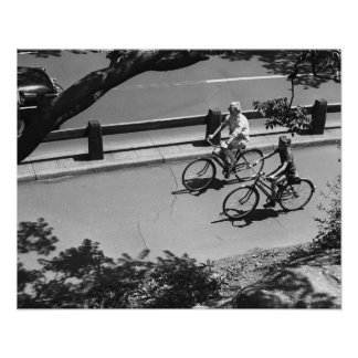 Man and Boy Cycling Poster