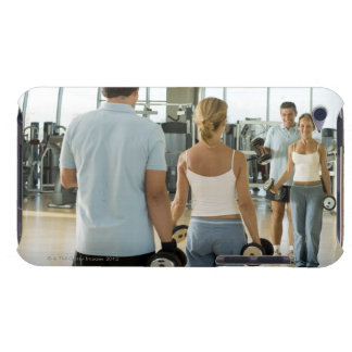 Man and woman lifting hand weights in front of a iPod touch Case-Mate case