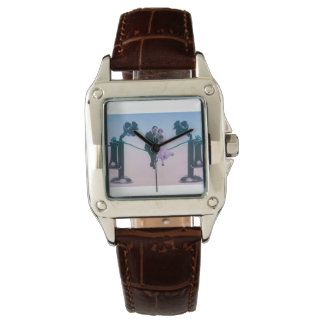 Man and woman sit on telephone wire 1900 wrist watch