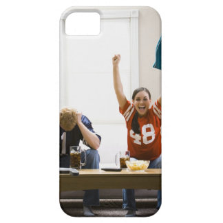 Man and woman sitting on sofa watching football case for the iPhone 5