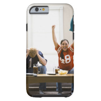 Man and woman sitting on sofa watching football tough iPhone 6 case