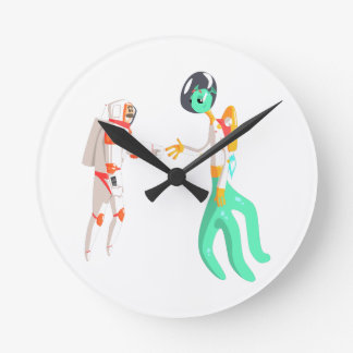 Man Astronaut Shaking Hands With Green Male Alien Round Clock