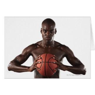 Man clutching basketball card