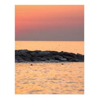 Man fishing at sunset letterhead