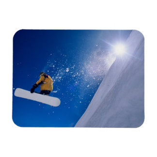 Man flying through the air on a snowboard with rectangular photo magnet