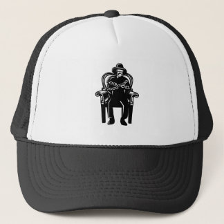 Man Gagged Chained to Grand Arm Chair Woodcut Trucker Hat
