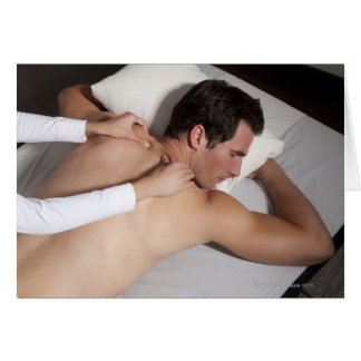 Man having a back massage from woman card