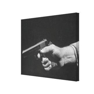 Man Holding Gun Canvas Print