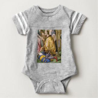 man in yellow kneels baby bodysuit