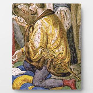 man in yellow kneels plaque