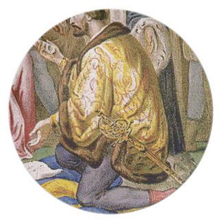 man in yellow kneels plate