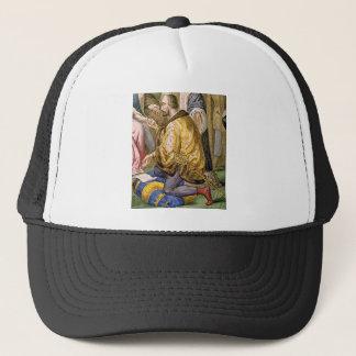 man in yellow kneels trucker hat
