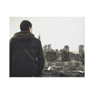 Man looking over City Canvas Print