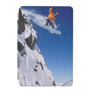 Man on a snowboard jumping off a cornice at iPad mini cover