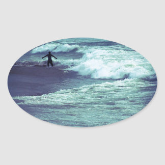 Man on Sea Waves Oval Sticker